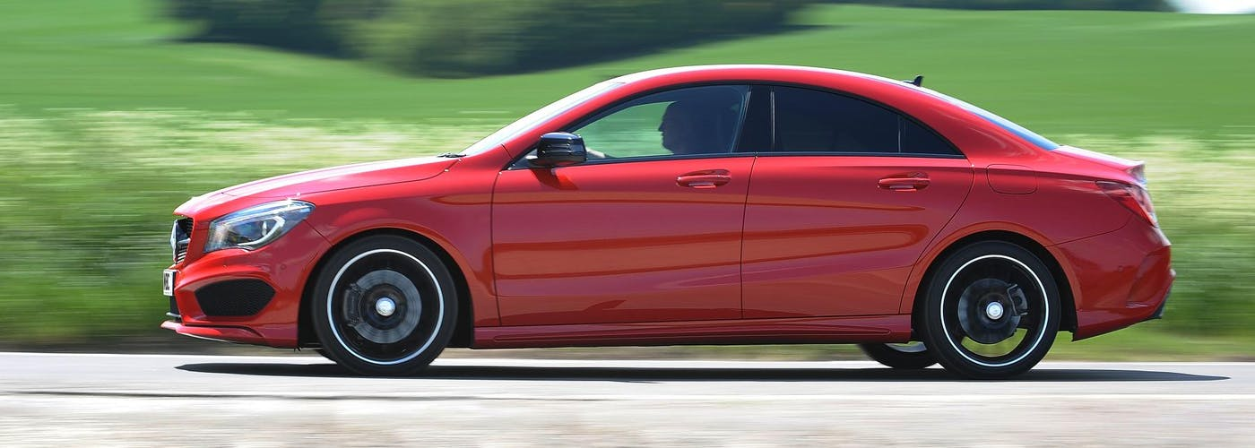The side exterior of a red Mercedes-Benz CLA