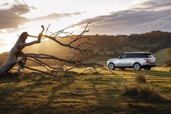 The side exterior of a silver Range Rover