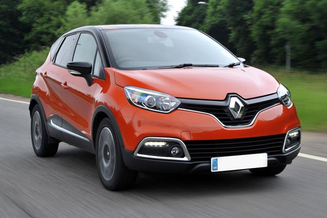 The exterior of a red Renault Captur