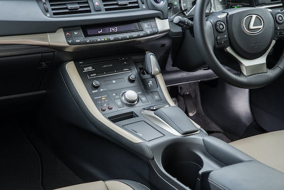 The interior of a Lexus CT with steering wheel and dashboard in shot