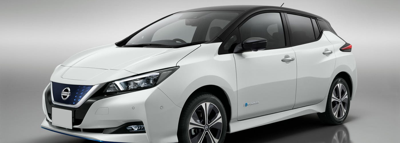 The front exterior of a white Nissan Leaf