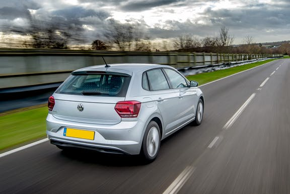 The rear exterior of a silver Volkswagen Polo