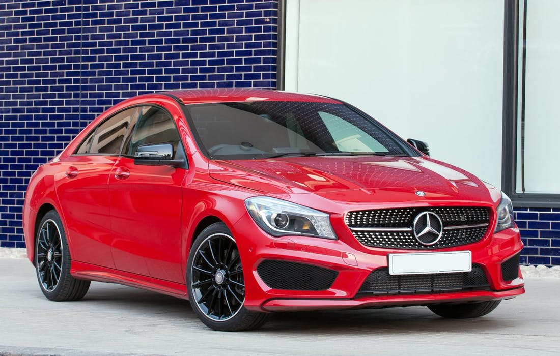The front exterior of a red Mercedes-Benz CLA