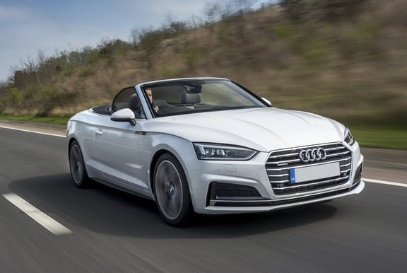 The front exterior of a white Audi A5 Cabriolet
