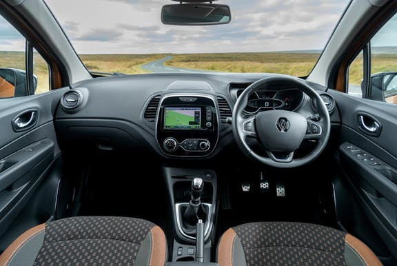 The interior of a Renault Captur with steeringwheel and dashboard in shot