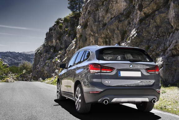 The rear exterior of a silver BMW X1