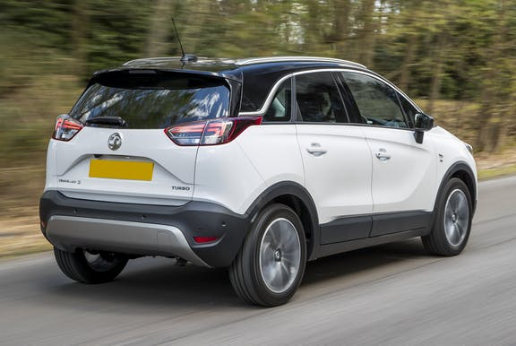 The rear exterior of a white Vauxhall Crossland X