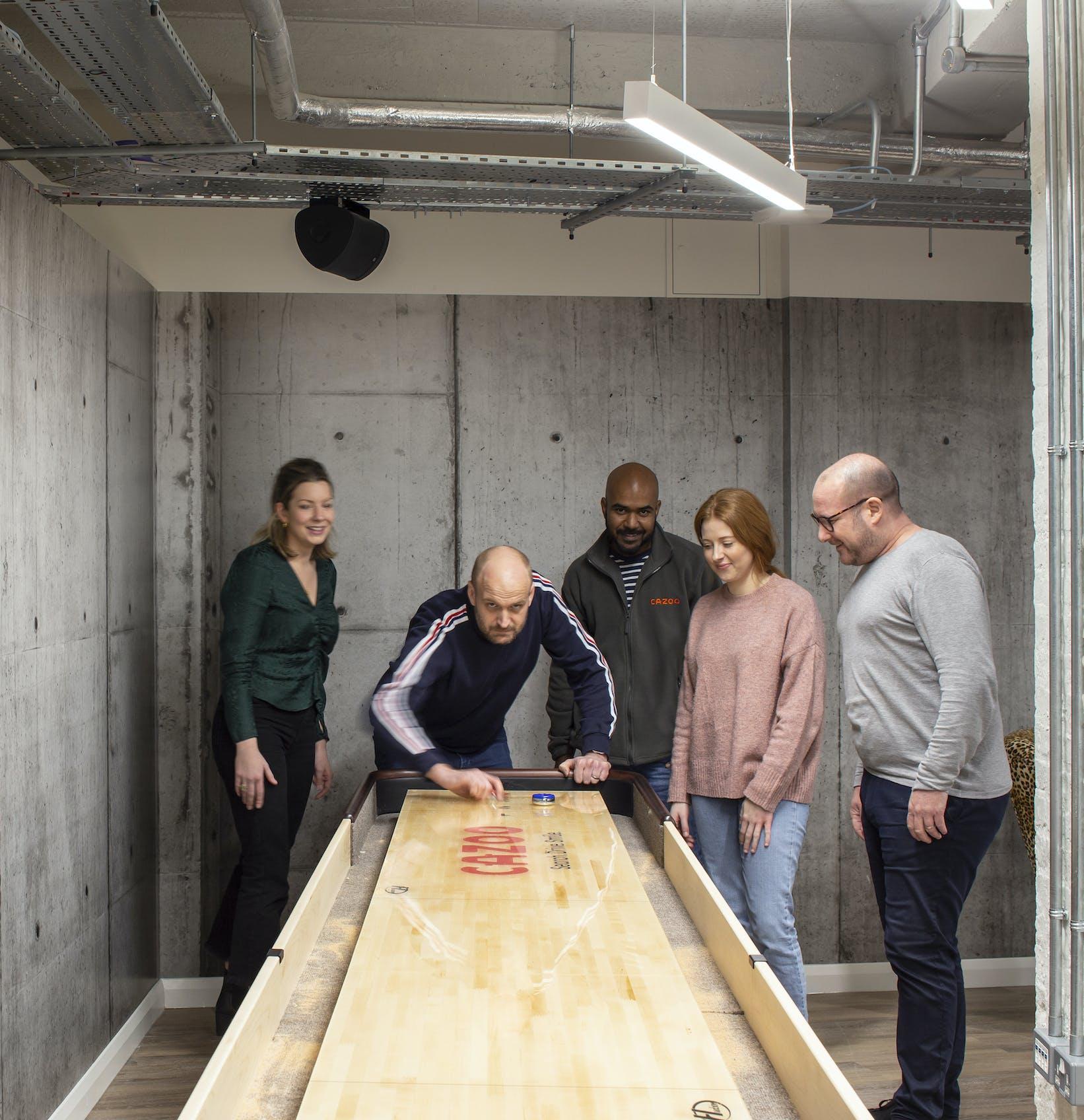 Cazoo staff playing shuffleboard