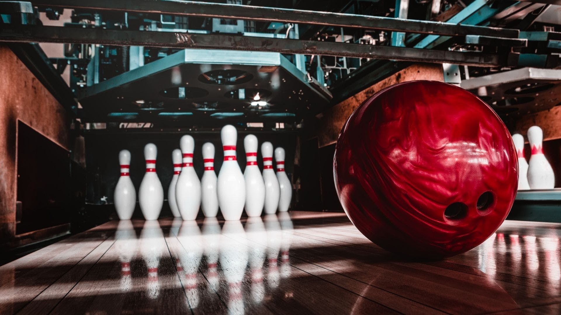 Bowling ball with pins in the background