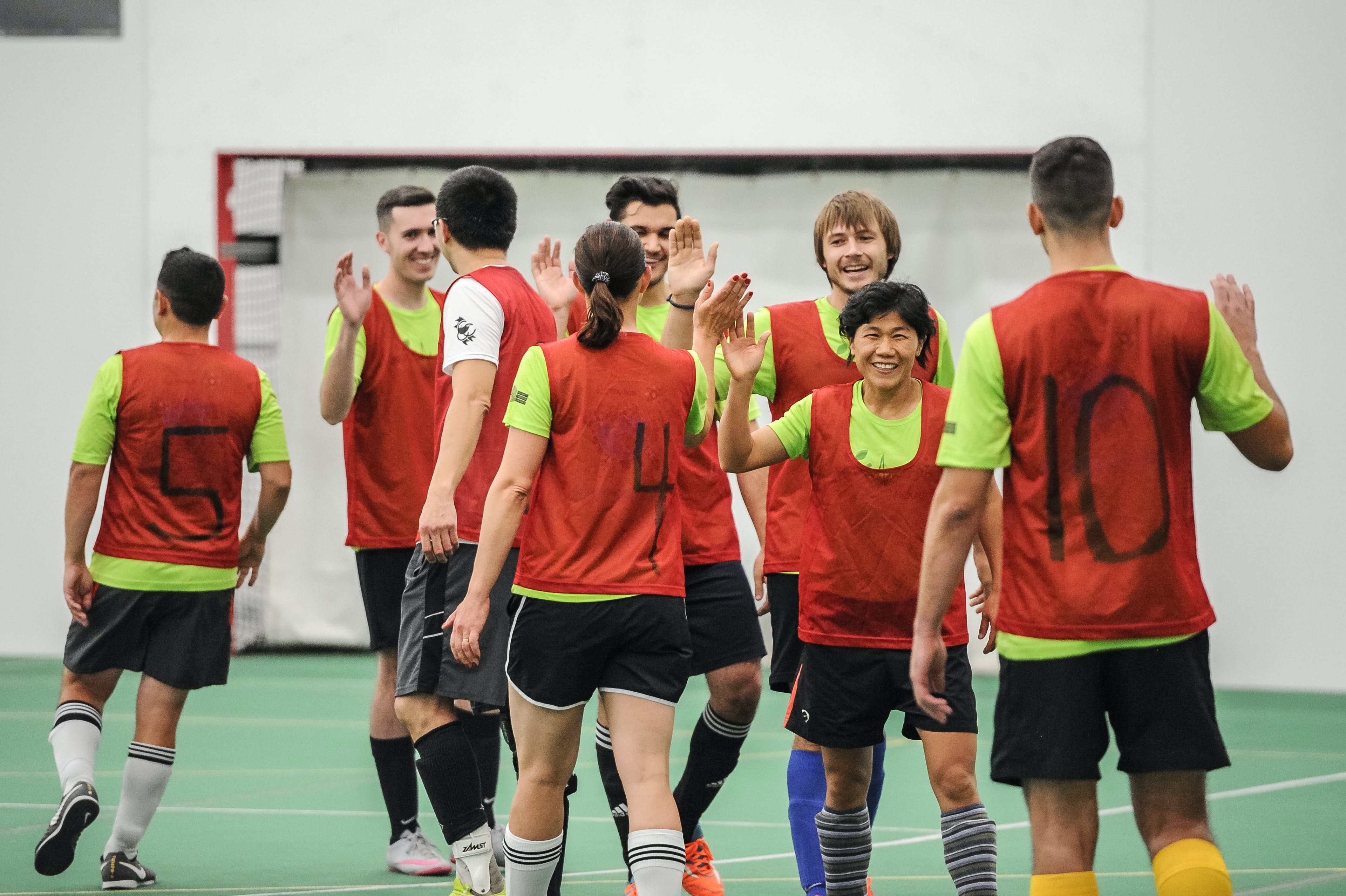 A soccer team celebrating after game