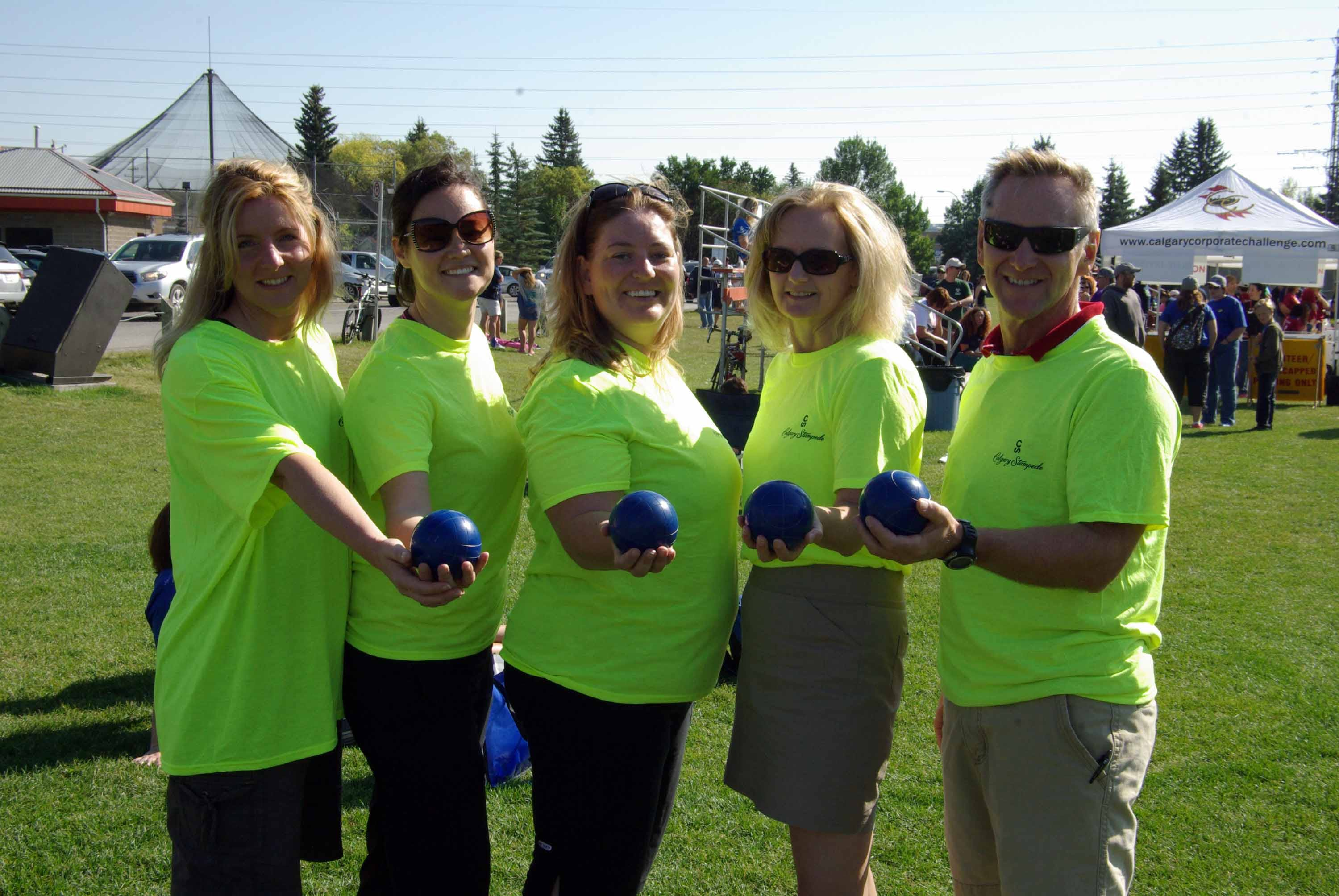 A group holding bocce balls