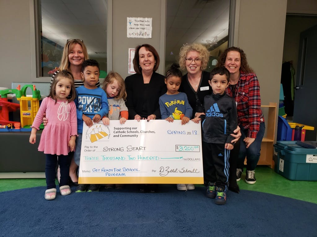 Strong Start Donation Cheque With Happy Kids