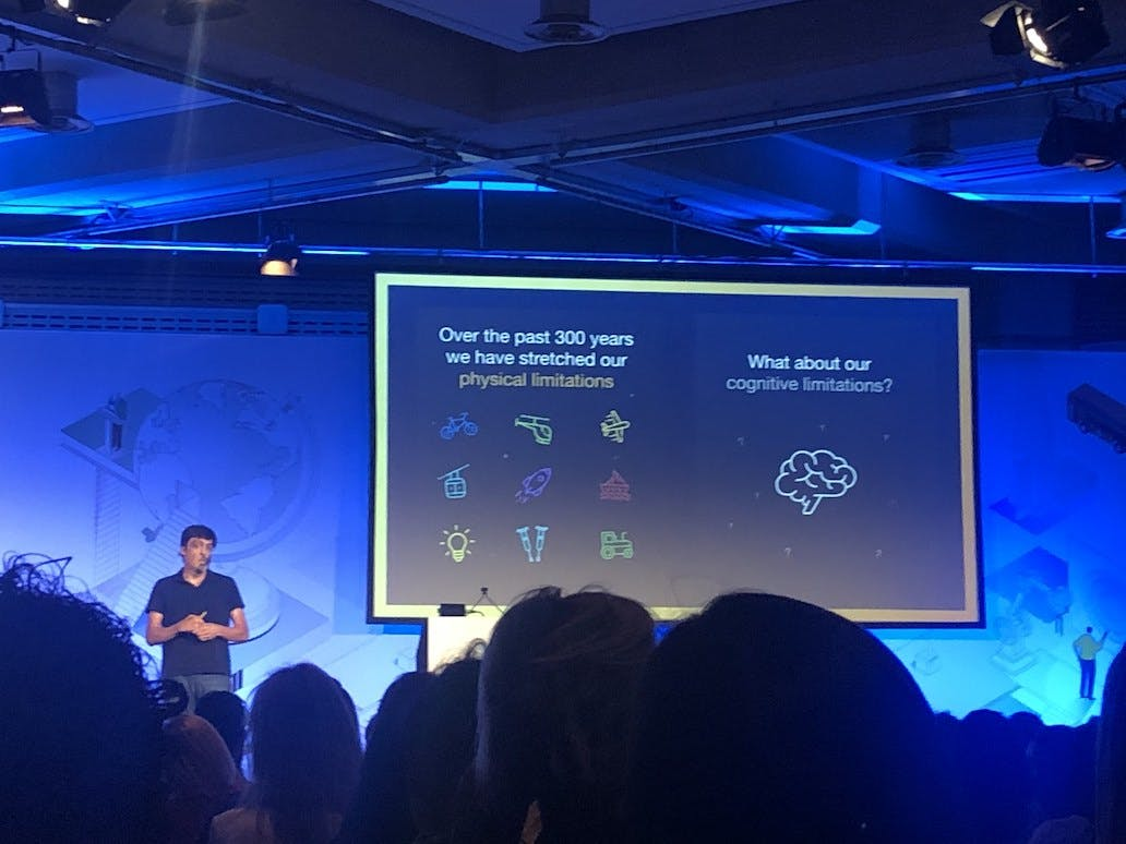 Prof. Dan Ariely presenting on stage