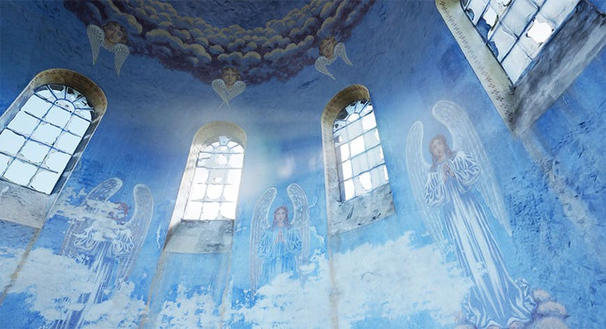 Close up of the domed ceiling of the historic Oleszyce Church in Poland, the wall of which is painted sky blue with angels