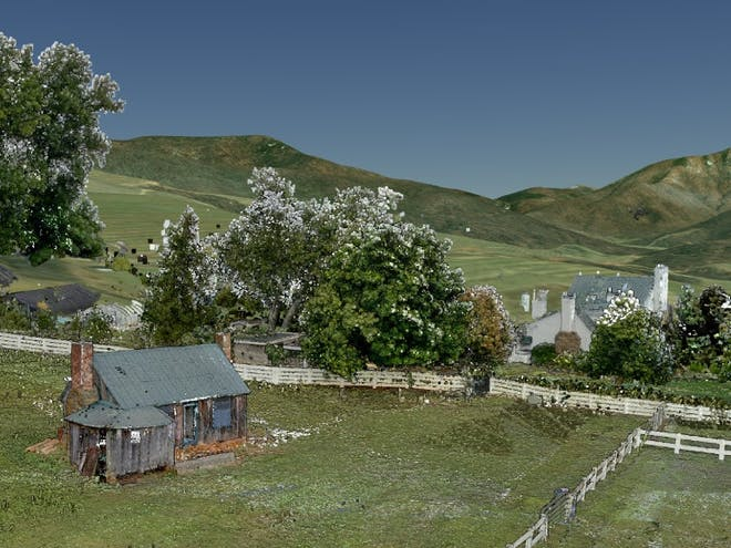 Point cloud data set of a cabin on farmland surrounded by hills and trees.