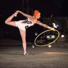 Hannah dances with a flaming hula hoop