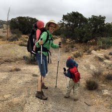Sarah Chow hiking with two children.