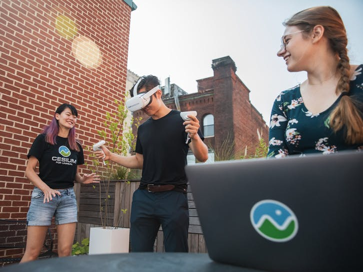 Gabby Getz, with Janine Liu and Xuelong Mu, testing VR applications in Cesium