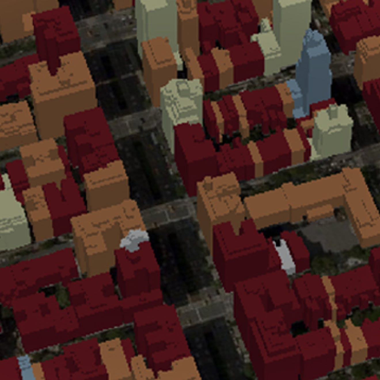 An aerial view of untextured models of 3D buildings, colored by year they were built