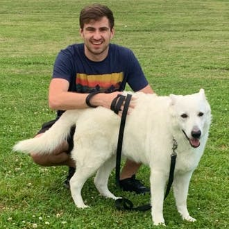 Joe Hines with a big white dog.