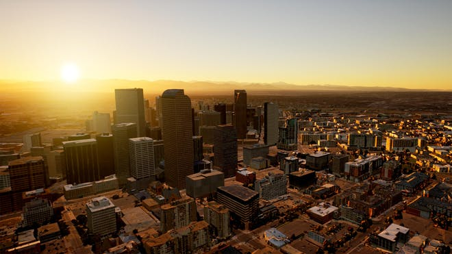 An aerial view of Denver at sunset in Unreal Engine