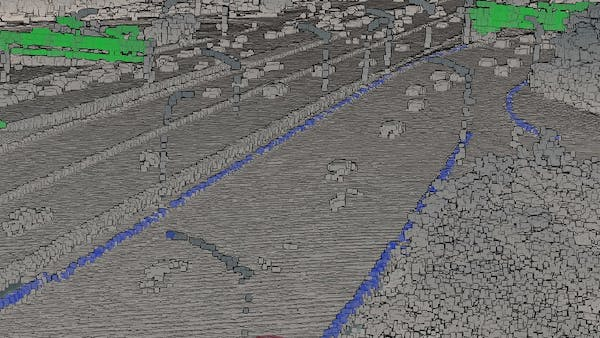 Point cloud data of Washington DC highway, classified at runtime using volumes from an independent data source indicating curbs and highway signs.