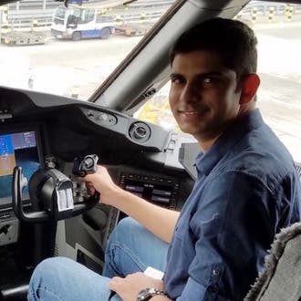 Shehzan Mohammed in the cockpit of an aircraft.