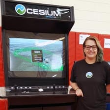 Gabby Getz with a Cesium branded arcade game.