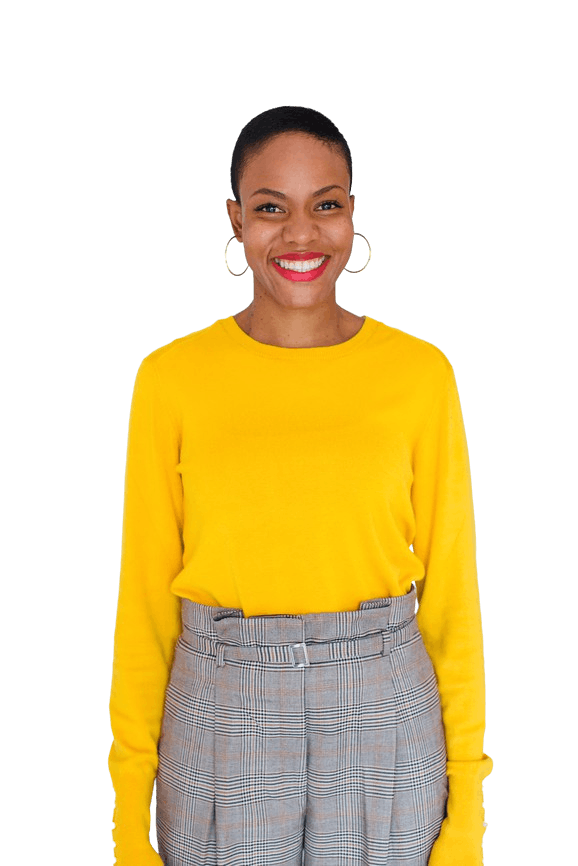 A cheerful woman in a bright yellow shirt with a big smile on her face