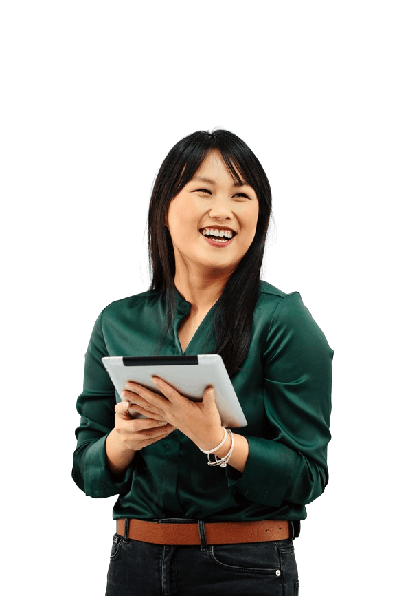 A cheerful woman in a green button-up shirt smiling while holding an iPad
