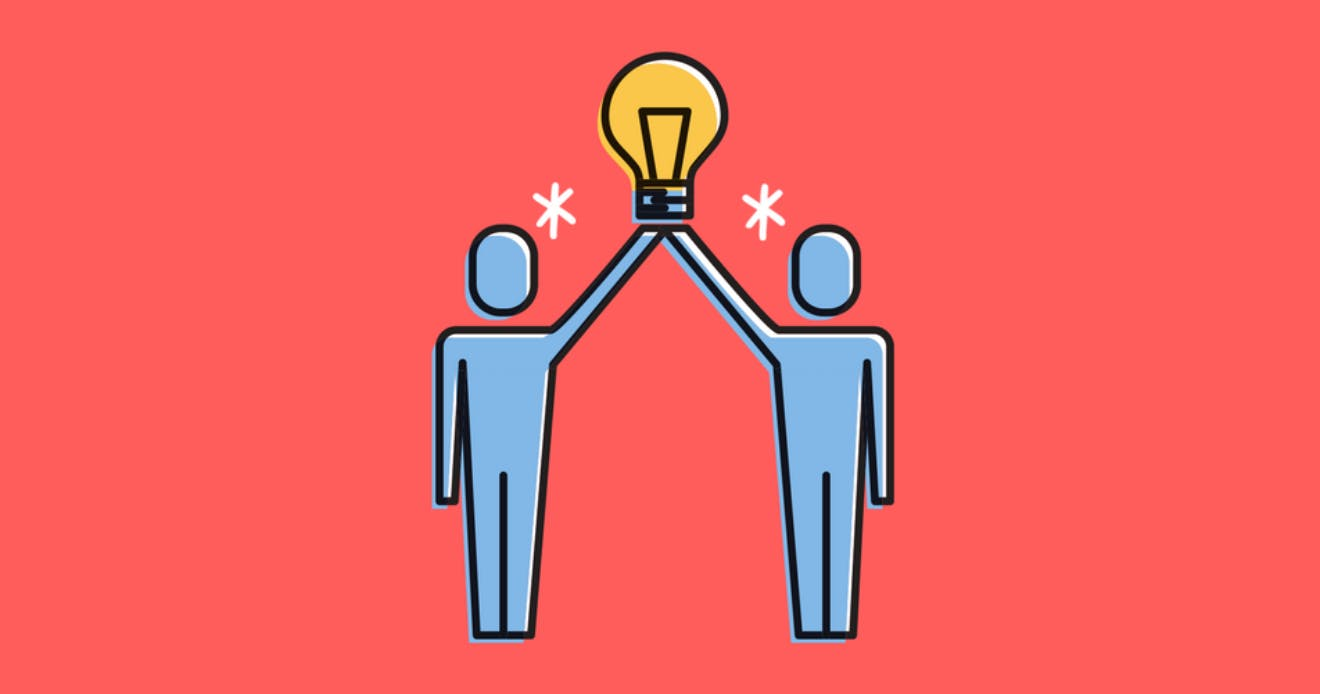 Two blue cartoon people standing next to each other holding up a yellow lightbulb in between them above their heads.