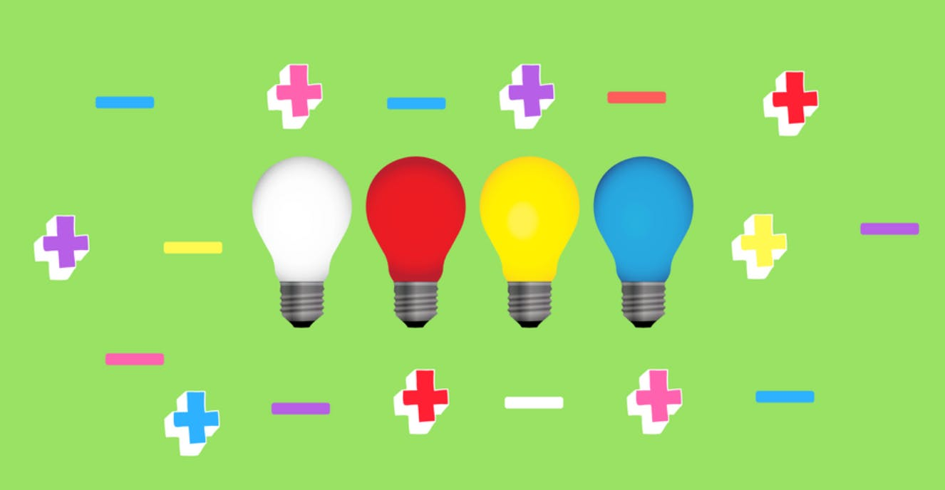 An illustration of a row of multi-coloured lightbulbs surrounded by multi-coloured plus signs and dashes.