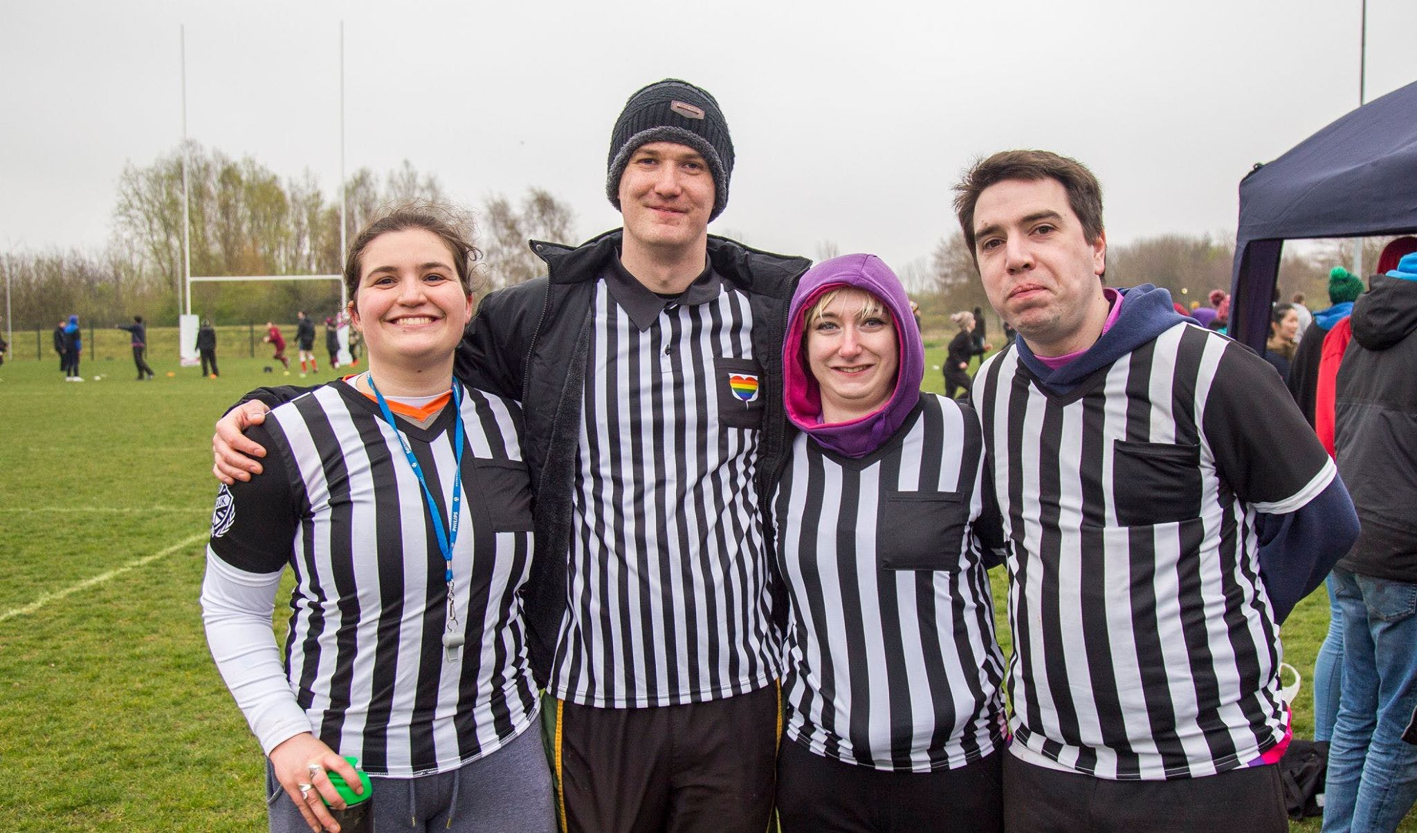 Refs pose together before a match, all wearing their referee shirts
