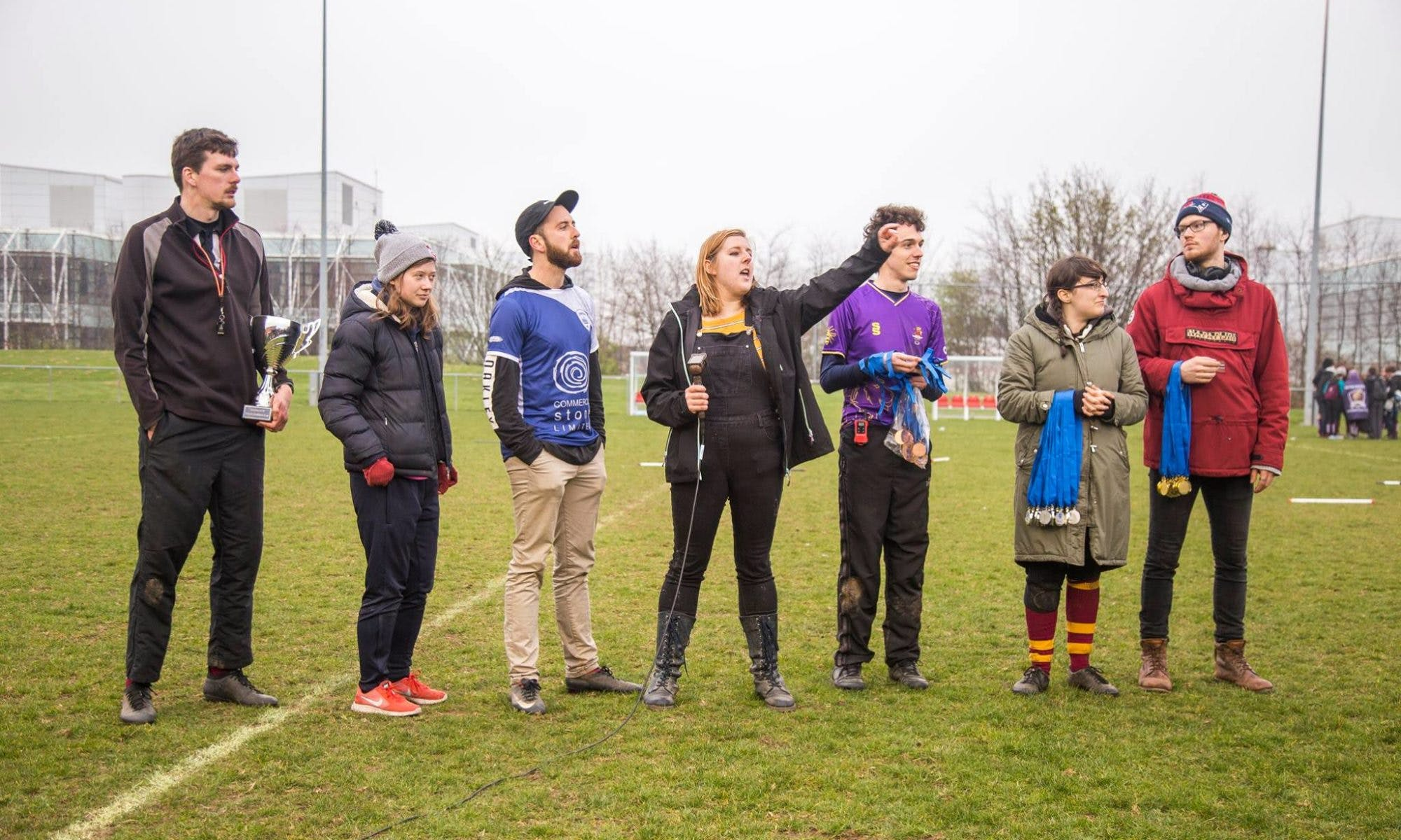 Tournament organisers lineup to award medals and the BQC Trophy