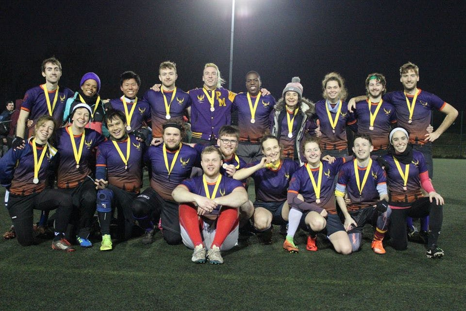 London Unspeakables pose for a team photo with their silver medals