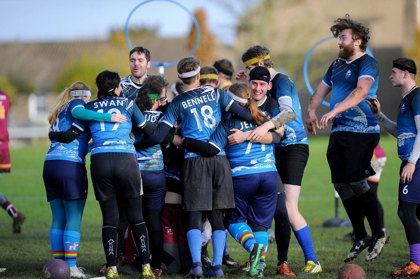 Southsea Quidditch celebrate in a group hug after winning a match