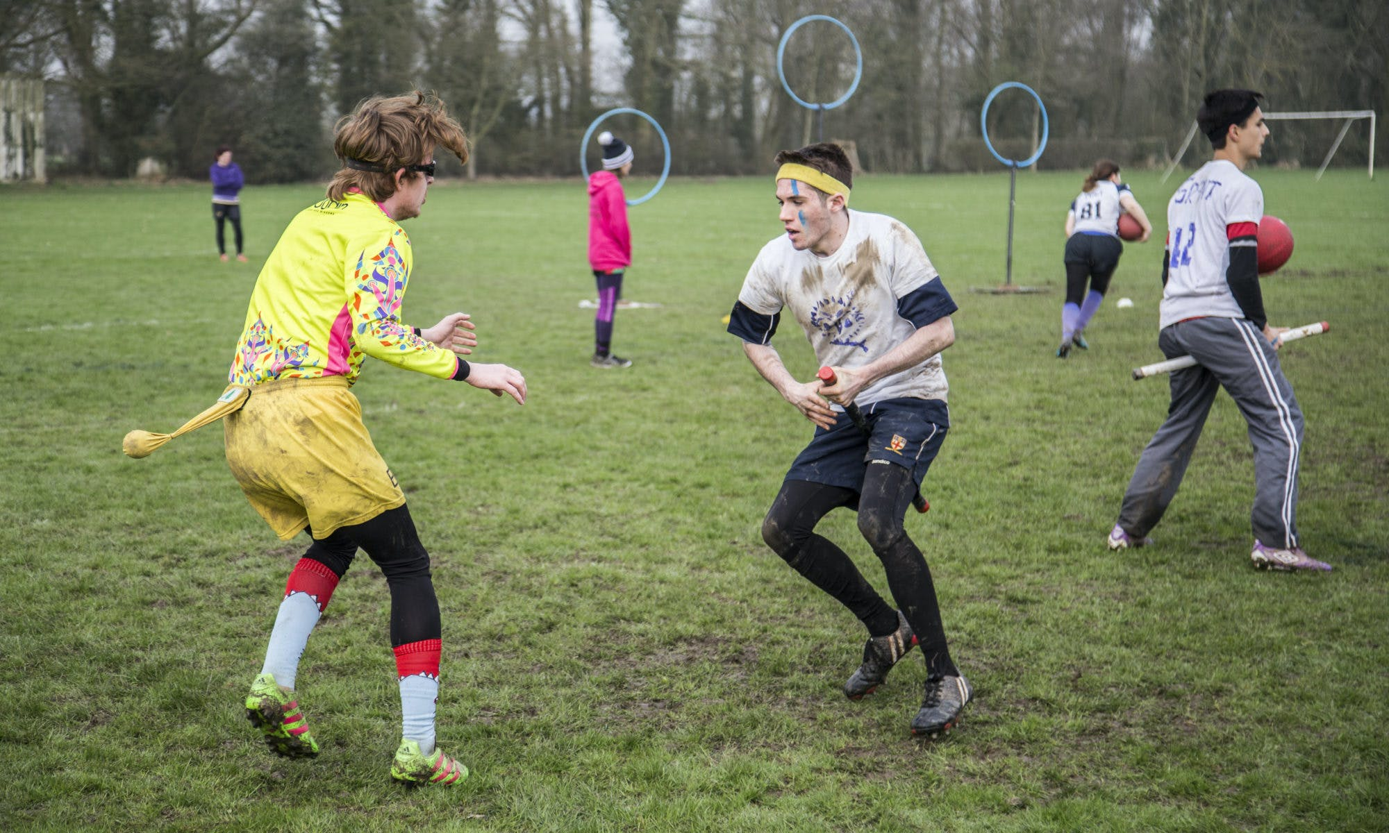 A seeker and snitch jockey for positioning during a match