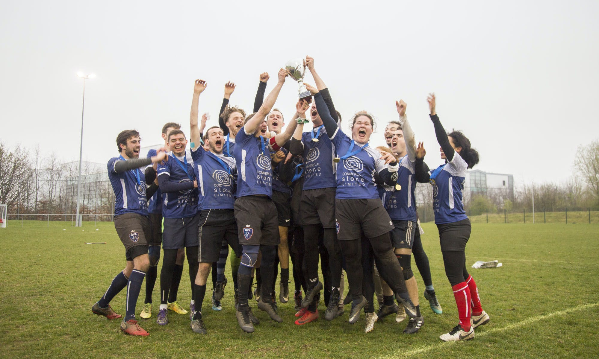 London Quidditch Club celebrate their BQC win by raising the trophy