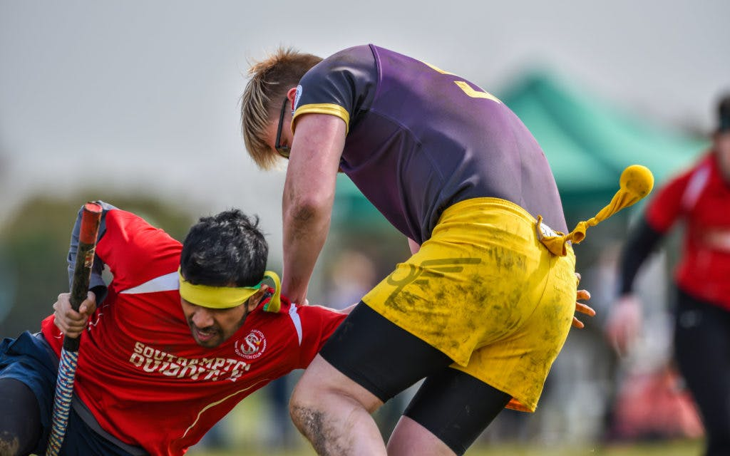 A Southampton Quidditch Club Seeker reaches for the snitch tail as the snitch runner pushes them away
