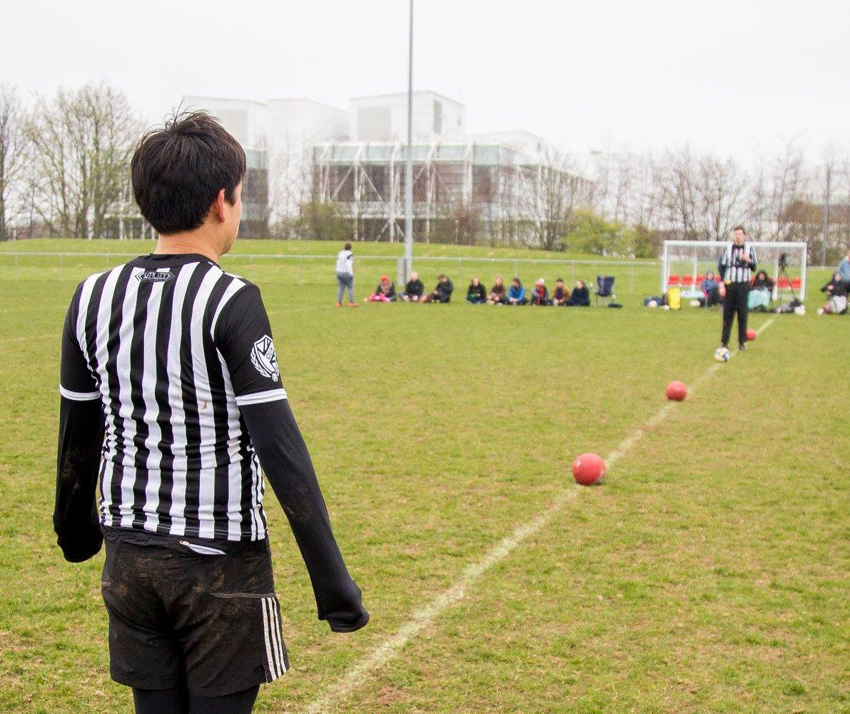A ref looks on to the halfway line ready for the game to start