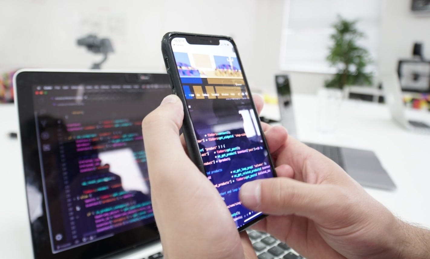 An app developer coding a mobile app