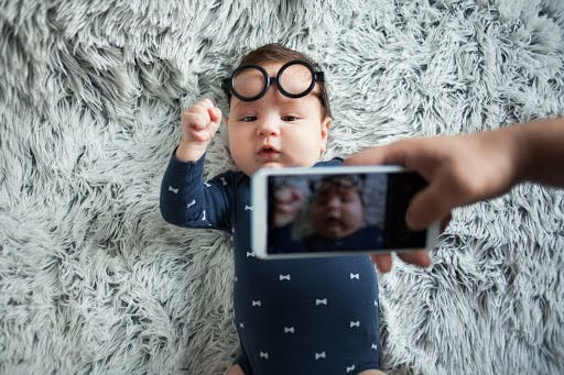 Photo of baby wearing glasses