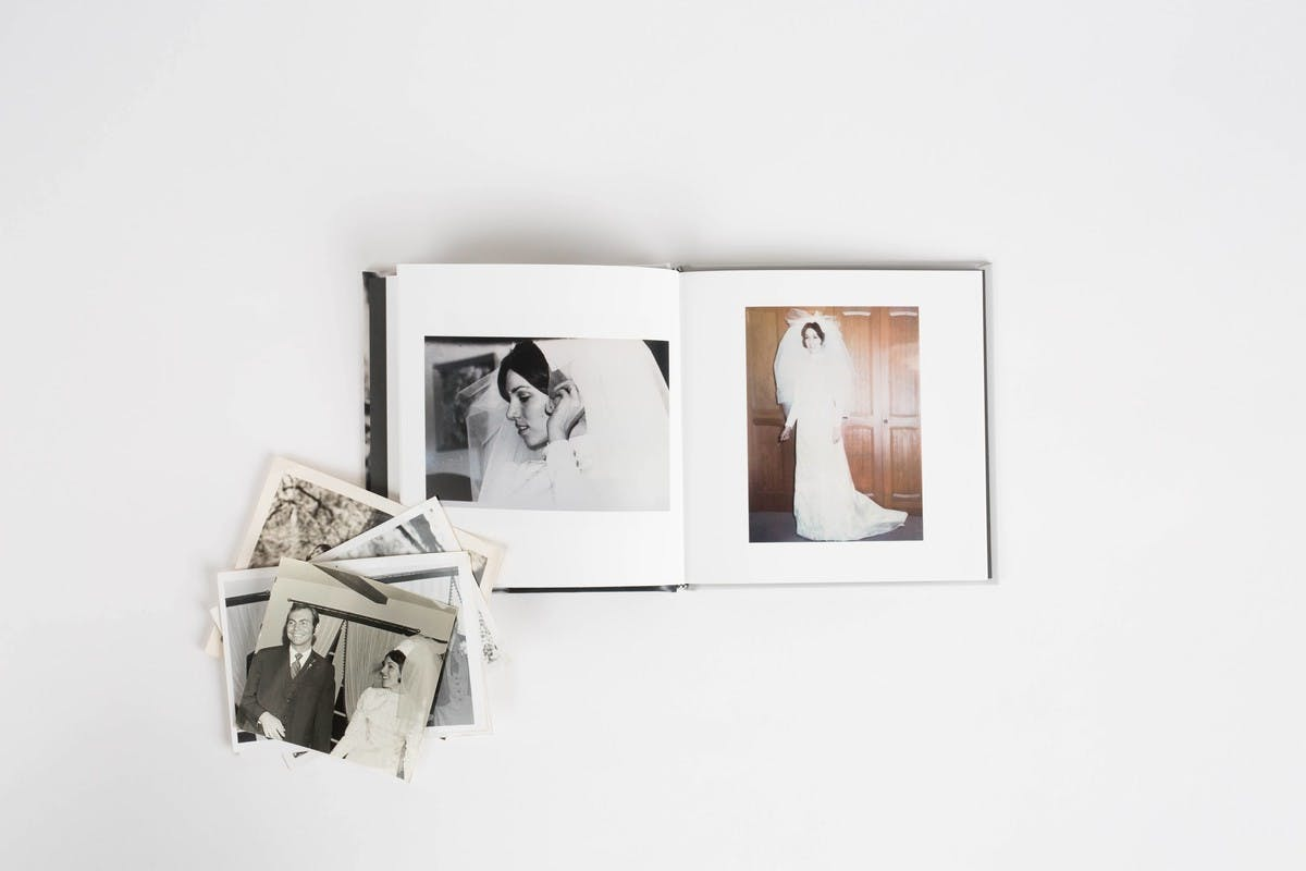 Chatbooks and old family photos on a white background