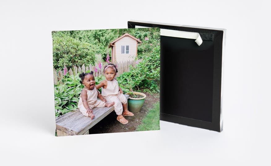 peel and stick photo tile showing two little girls sitting on bench in garden