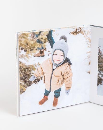 layflat photo album of little boy in snow