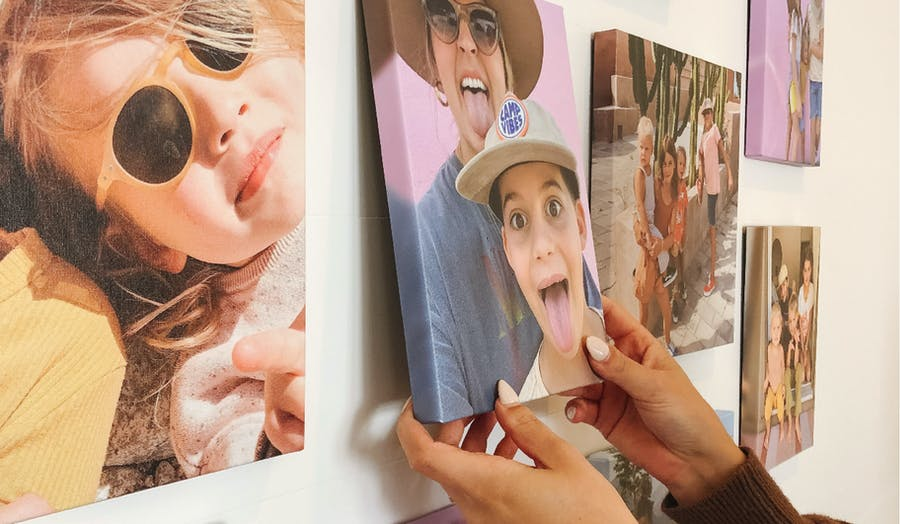 woman hands hanging up canvas prints