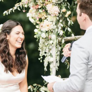 couple laughing on wedding day