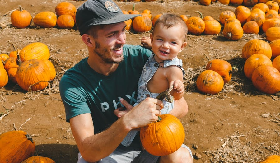 Dad with baby at pumpkin patch
