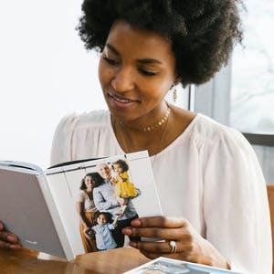 mom reading page of family photo album gift