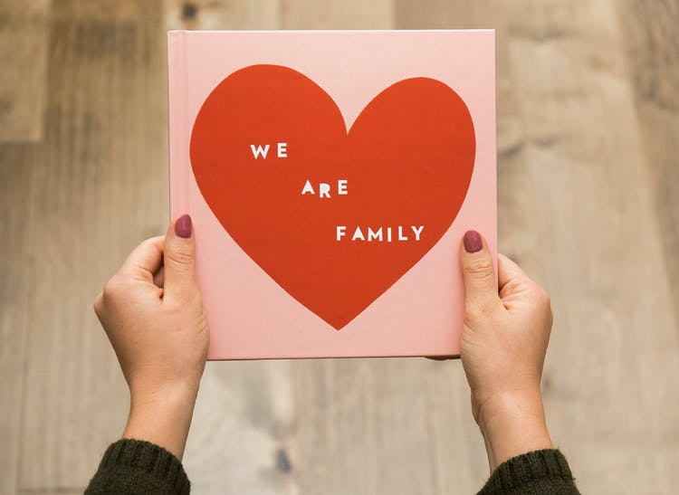 family photo album with designer cover that says we are family